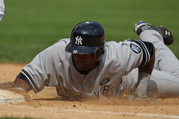 CHICAGO - AUGUST 29: Eduardo Nunez #12 of the New York Yankees dives back to first base during a game against the Chicago White Sox at U.S. Cellular Field on August 29, 2010 in Chicago, Illinois. The Yankees defeated the White Sox 2-1. (Photo by Jonathan