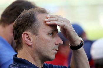 ARLINGTON, TX - OCTOBER 16:  General Manager of the New York Yankees Brian Cashman look on during a game against the Texas Rangers in Game Two of the ALCS during the 2010 MLB Playoffs at Rangers Ballpark in Arlington on October 16, 2010 in Arlington, Texa