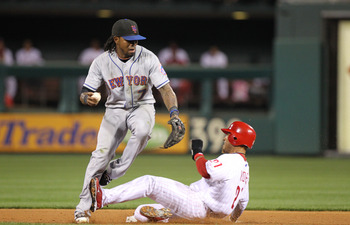 PHILADELPHIA - SEPTEMBER 25: Shortstop Jose Reyes #7 of the New York Mets attempts to avoid the slide of shortstop Wilson Valdez #21 of the Philadelphia Phillies during a game at Citizens Bank Park on September 25, 2010 in Philadelphia, Pennsylvania. The