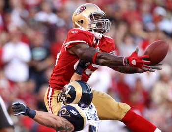 SAN FRANCISCO - NOVEMBER 14:  Vernon Davis #85 of the San Francisco 49ers catches the ball in the endzone over James Laurinaitis #55 of the St. Louis Rams at Candlestick Park on November 14, 2010 in San Francisco, California. The touchdown was not allowed