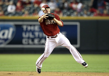 PHOENIX - SEPTEMBER 22:  Infielder Stephen Drew #6 of the Arizona Diamondbacks fields a ground ball out against the Colorado Rockies during the Major League Baseball game at Chase Field on September 22, 2010 in Phoenix, Arizona.  (Photo by Christian Peter