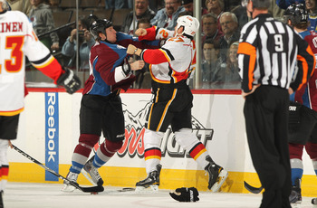 DENVER - NOVEMBER 09:  Steve Staios #27 of the Calgary Flames and Cody McLeod #55 of the Colorado Avalanche engage in a fight during the first period at the Pepsi Center on November 9, 2010 in Denver, Colorado.  (Photo by Doug Pensinger/Getty Images)