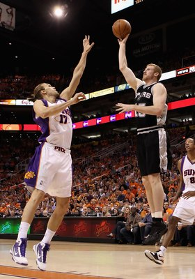 PHOENIX - MAY 03:  Matt Bonner #15 of the San Antonio Spurs puts up a shot against Louis Amundson #17 of the Phoenix Suns during Game One of the Western Conference Semifinals of the 2010 NBA Playoffs at US Airways Center on May 3, 2010 in Phoenix, Arizona