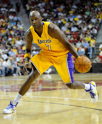 LAS VEGAS - OCTOBER 13:  Lamar Odom #7 of the Los Angeles Lakers brings the ball up the court against the Sacramento Kings during their preseason game at the Thomas & Mack Center October 13, 2010 in Las Vegas, Nevada. The Lakers won 98-95. NOTE TO USER: U