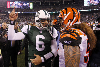 EAST RUTHERFORD, NJ - NOVEMBER 25:  Rey Maualuga #58 of the Cincinnati Bengals speaks with Quarterback Mark Sanchez #6 of the New York Jets following their game at New Meadowlands Stadium on November 25, 2010 in East Rutherford, New Jersey. The Jets defea