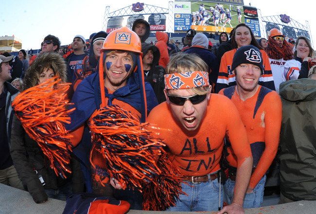 AUBURN, AL - NOVEMBER 6:  Fans of the Auburn Tigers cheer play against the Chattanooga Mocs November 6, 2010 at Jordan-Hare Stadium in Auburn, Alabama.  (Photo by Al Messerschmidt/Getty Images)