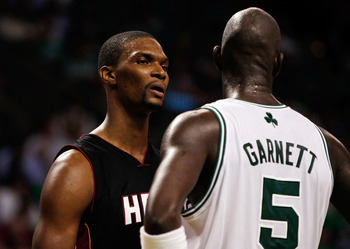BOSTON, MA - OCTOBER 26: Chris Bosh #1 of the Miami Heat has words with Kevin Garnett #5 of the Boston Celtics at the TD Banknorth Garden on October 26, 2010 in Boston, Massachusetts.  The Heat lost 88-80. NOTE TO USER: User expressly acknowledges and agr