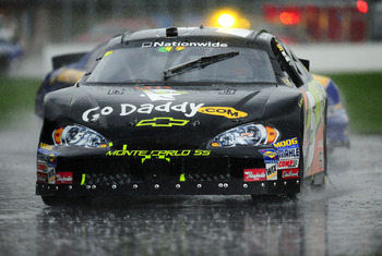 MONTREAL, QC - AUGUST 02: Ron Fellows driver of the #5 Rick Hendrick GoDaddy.com Chevrolet drives in the rain before the last red flag is called during the NASCAR Nationwide Series Napa Auto Parts 200 Montreal presented by Dodge on August 2, 2008 at the C