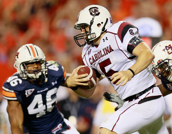 AUBURN, AL - SEPTEMBER 25:  Quarterback Stephen Garcia #5 of the South Carolina Gamecocks rushes upfield against Craig Stevens #46 and Antoine Carter #45 of the Auburn Tigers at Jordan-Hare Stadium on September 25, 2010 in Auburn, Alabama.  (Photo by Kevi
