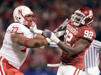 KANSAS CITY, MO - DECEMBER 2: Larry Birdine #92 of the Oklahoma Sooners is blocked by Carl Nicks #77 of the Nebraska Cornhuskers during the 2006 Dr. Pepper Big 12 Championship on December 2, 2006 at Arrowhead Stadium in Kansas City, Missouri. The Sooners