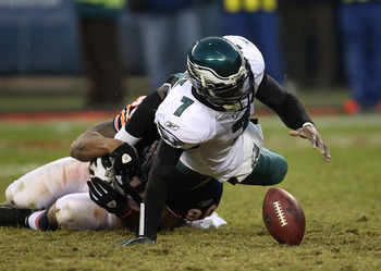 CHICAGO - NOVEMBER 28: Michael Vick #7 of the Philadelphia Eagles fumbles the ball as he is sacked by Julius Peppers #90 of the Chicago Bears at Soldier Field on November 28, 2010 in Chicago, Illinois. The Bears defeated the Eagles 31-26. (Photo by Jonath