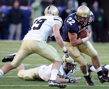 BALTIMORE - DECEMBER 01:  Adam Ballard #22 of the Navy Midshipmen runs the ball against Jordan Murray #19 of the Army Black Knights during the 108th Army v Navy football game on December 1, 2007 at M&T Bank Stadium in Baltimore, Maryland.  (Photo by Jim M