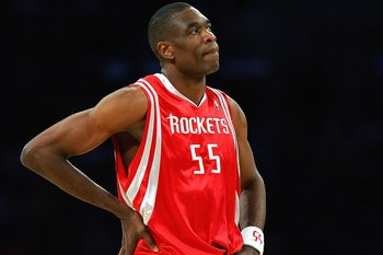LOS ANGELES - MARCH 30:  Dikembe Mutombo #55 of the Houston Rockets looks on against the Los Angeles Lakers at Staples Center on March 30, 2007 in Los Angeles, California. The Rockets won 107-104. NOTE TO USER: User expressly acknowledges and agrees that,