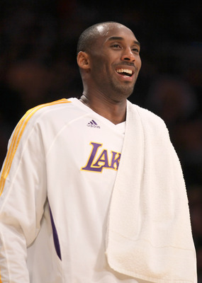 LOS ANGELES - NOVEMBER 21:  Kobe Bryant #24 of the Los Angeles Lakers laughs as he looks on from the bench against the Golden State Warriors at Staples Center on November 21, 2010 in Los Angeles, California.   NOTE TO USER: User expressly acknowledges and