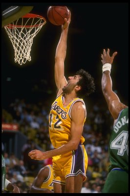 12 Dec 1990:  Center Vlade Divac of the Los Angeles Lakers goes up for two during a game against the Dallas Mavericks at Great Western Forum in Inglewood, California. Mandatory Credit: Mike Powell  /Allsport Mandatory Credit: Mike Powell  /Allsport