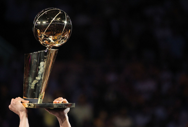 LOS ANGELES, CA - JUNE 17:  The Los Angeles Lakers hold up the Larry O'Brien Trophy after the Lakers defeated the Boston Celtics in Game Seven of the 2010 NBA Finals at Staples Center on June 17, 2010 in Los Angeles, California.  NOTE TO USER: User expres