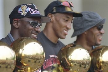 16 Jun 1997: Guard Michael Jordan, forward Scottie Pippen and forward Dennis Rodman of the Chicago Bulls look at their trophies during the Chicago Bulls Victory Parade in Chicago, Illinois. The BUlls defeated the Utah Jazz in 6 games to win the 1998 NBA C