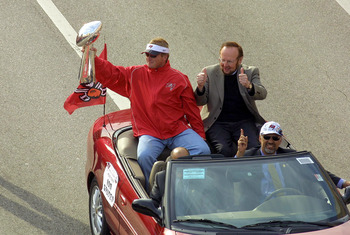 TAMPA, FL - JANUARY 28:  Head Coach Jon Gruden of the Tampa Bay Buccaneers rides with team Owner/President Malcolm Glazer during a victory parade on January 28, 2003 in Tampa, Florida. The Buccaneers defeated the Oakland Raiders 48-21 in Super Bowl XXXVII
