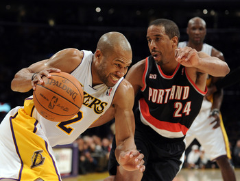 LOS ANGELES, CA - NOVEMBER 07:  Derek Fisher #2 of the Los Angeles Lakers attempts to dribble around Andre Miller #24 of the Portland Trail Blazers at the Staples Center on November 7, 2010 in Los Angeles, California.  NOTE TO USER: User expressly acknowl