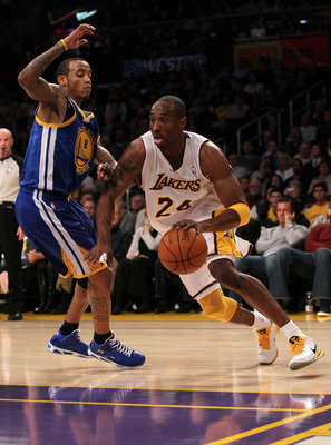 LOS ANGELES, CA - NOVEMBER 21:  Kobe Bryant #24 of the Los Angeles Lakers drives around Monta Ellis #8 of the Golden State Warriors at Staples Center on November 21, 2010 in Los Angeles, California.  The User expressly acknowledges and agrees that, by dow