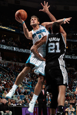 NEW ORLEANS - NOVEMBER 28:  Marco Belinelli #8 of the New Orleans Hornets shoots the ball over Tim Duncan #21 of the San Antonio Spurs at the New Orleans Arena on November 28, 2010 in New Orleans, Louisiana.  NOTE TO USER: User expressly acknowledges and