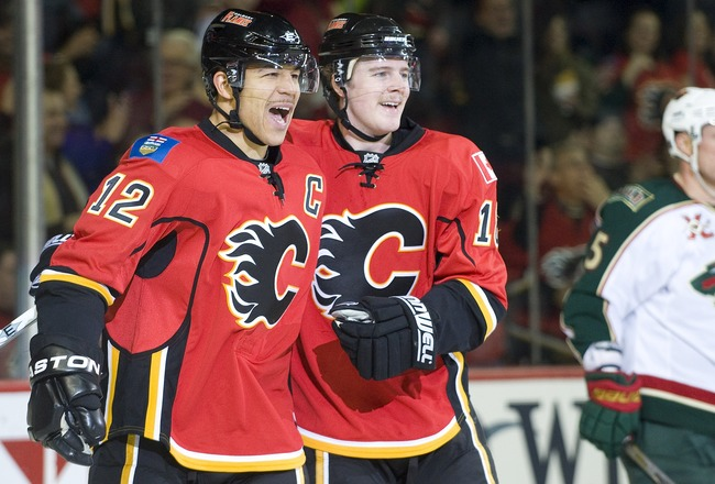 EDMONTON, AB - NOVEMBER 29:  Matt Stajan #18 and Jarome Iginla #12 of the Calgary Flames celebrate a second period goal against the Minnesota Wild at Scotiabank Saddledome on November 29, 2010 in Calgary, Alberta, Canada. (Photo by Dylan Lynch/Getty Image
