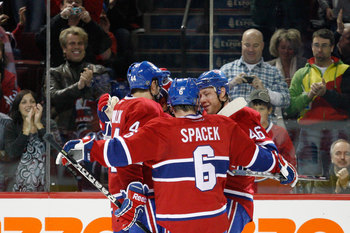 MONTREAL- NOVEMBER 27:  Members of the Montreal Canadiens celebrate the second period goal by Brian Gionta #21 during the NHL game against the Buffalo Sabres at the Bell Centre on November 27, 2010 in Montreal, Quebec, Canada.  The Canadiens defeated the