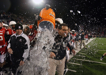 MUNCIE, IN - NOVEMBER 25:  Head coach Brady Hoke of the Ball State Cardinals is splashed with water in the final seconds of the Mid-American Conference (MAC) game against the Western Michigan Broncos at Scheumann Stadium November 25, 2008 in Muncie, India