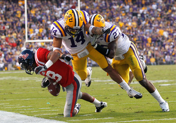 BATON ROUGE, LA - NOVEMBER 20:  Tyrann Mathieu #14 of the Louisiana State University Tigers is called for a helmet-to-helmet contact penalty after hitting Korvic Neat #28 of the Ole Miss Rebels at Tiger Stadium on November 20, 2010 in Baton Rouge, Louisia