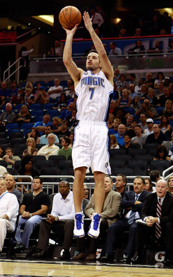 ORLANDO, FL - OCTOBER 10:  J.J. Redick #7 of the Orlando Magic attempts a shot during the game against the New Orleans Hornets at Amway Arena on October 10, 2010 in Orlando, Florida. NOTE TO USER: User expressly acknowledges and agrees that, by downloadin