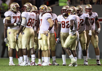 RALEIGH, NC - OCTOBER 28:  Christian Ponder #7 of the Florida State Seminoles huddles with his team against the North Carolina State Wolfpack during their game at Carter-Finley Stadium on October 28, 2010 in Raleigh, North Carolina.  (Photo by Streeter Le