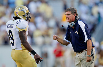 ATLANTA - OCTOBER 09:  Head coach Paul Johnson converses with quarterback Joshua Nesbitt #9 of the Georgia Tech Yellow Jackets in between downs against the Virginia Cavaliers at Bobby Dodd Stadium on October 9, 2010 in Atlanta, Georgia.  (Photo by Kevin C