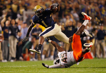 PITTSBURGH - SEPTEMBER 23:  Ray Graham #1 of the Pittsburgh Panthers evades a tackle by Ramon Buchanan #45 of the Miami Hurricanes on September 23, 2010 at Heinz Field in Pittsburgh, Pennsylvania.  (Photo by Jared Wickerham/Getty Images)