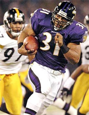 Jamal Lewis breaks loose for a 25 yard touchdown and topples 2000 yards