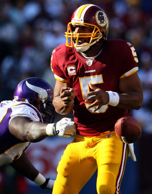 LANDOVER, MD - NOVEMBER 28:  Quarterback Donovan McNabb fumbles the ball while getting hit in the pocket against the Minnesota Vikings at FedExField November 28, 2010 in Landover, Maryland. The Vikings won the game 17-13.  (Photo by Win McNamee/Getty Imag