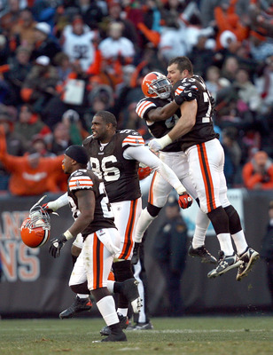 CLEVELAND - NOVEMBER 28:  Defensive players Clifton Smith #28, David Bowens #96, T.J. Ward #43 and Joe Thomas #73 of the Cleveland Browns celebrate after their game against the Carolina Panthers at Cleveland Browns Stadium on November 28, 2010 in Clevelan