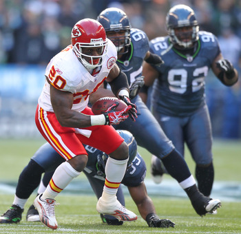 SEATTLE, WA - NOVEMBER 28:  Running back Thomas Jones #20 of the Kansas City Chiefs rushes against Aaron Curry #59 of the Seattle Seahawks at Qwest Field on November 28, 2010 in Seattle, Washington. (Photo by Otto Greule Jr/Getty Images)