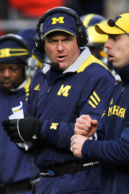 COLUMBUS, OH - NOVEMBER 27:  Head Coach Rich Rodriguez of the Michigan Wolverines watches one of his assistants send in a play against the Ohio State Buckeyes at Ohio Stadium on November 27, 2010 in Columbus, Ohio.  (Photo by Jamie Sabau/Getty Images)
