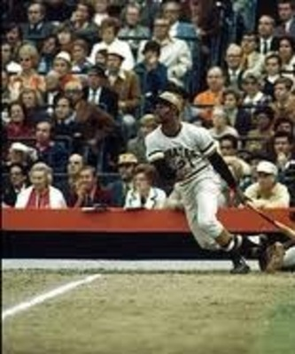 Clemente hits one of his two world series home runs