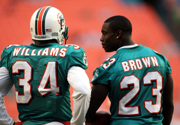 MIAMI - AUGUST 23: Running backs Ricky Williams #34 and Ronnie Brown #23 of the Miami Dolphins chat prior to a preseason game against the Kansas City Chiefs on August 23, 2008 at Dolphin Stadium in Miami, Florida.  (Photo by Marc Serota/Getty Images)