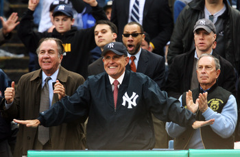 NEW YORK - APRIL 02:  Former New York City Major Rudolph Giuliani (C) and current mayor Michael Bloomberg (R) watch the New York Yankees play the Tampa Bay Devil Rays during their Opening Day game at Yankee Stadium April 2, 2007 in the Bronx borough of Ne