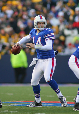 ORCHARD PARK, NY - NOVEMBER 28:  Ryan Fitzpatrick #14  of the Buffalo Bills throws against the Pittsburgh Steelers at Ralph Wilson Stadium on November 28, 2010 in Orchard Park, New York. Pittsburgh won 19-16 in overtime.  (Photo by Rick Stewart/Getty Imag