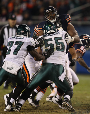 CHICAGO - NOVEMBER 28: J'Marcus Webb #73 of the Chicago Bears takes on Stewart Bradley #55 and Quintin Mikell #27 of the Philadelphia Eagles at Soldier Field on November 28, 2010 in Chicago, Illinois. The Bears defeated the Eagles 31-26. (Photo by Jonatha