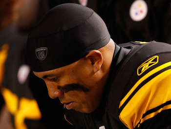 PITTSBURGH, PA - NOVEMBER 14:  Hines Ward #86 of the Pittsburgh Steelers sits on the bench after suffering a concussion during the game against the New England Patriots on November 14, 2010 at Heinz Field in Pittsburgh, Pennsylvania.  (Photo by Jared Wick