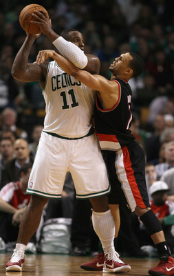 BOSTON - DECEMBER 01:  Glen Davis #11 of the Boston Celtics tries to keep the ball from Brandon Roy #7 of the Portland Trailblazers on December 1, 2010 at the TD Garden in Boston, Massachusetts. The Celtics defeated the Trailblazers 99-95. NOTE TO USER: U