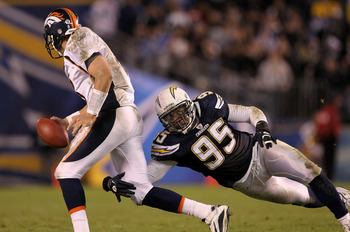 SAN DIEGO - NOVEMBER 22:  Linebacker Shaun Phillips #95 of the San Diego Chargers tackles quarterback Kyle Orton #8 of the Denver Broncos on an unsuccessful fleaflicker play at Qualcomm Stadium on November 22, 2010 in San Diego, California.  (Photo by Ste