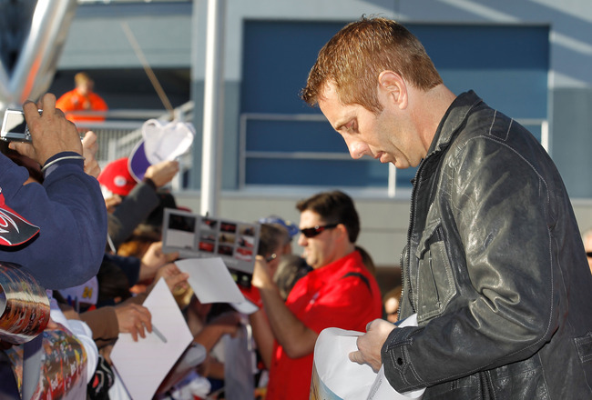 LAS VEGAS, NV - DECEMBER 01:  Greg Biffle (R), driver of the #16 3M Ford, and Tony Stewart (C), driver of the #14 Old Spice/Office Depot Chevrolet, sign autographs during day 2 of the NASCAR Sprint Cup Series Champions Week at Las Vegas Motor Speedway on