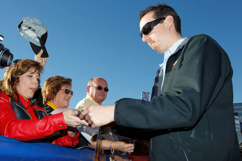 NASCAR Chasers took their time walking on the red carpet as they signed plenty of autographs.