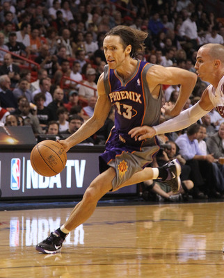 MIAMI - NOVEMBER 17:  Steve Nash #13  of the Phoenix Suns drives to the rim during a game against the  Miami Heat at American Airlines Arena on November 17, 2010 in Miami, Florida. NOTE TO USER: User expressly acknowledges and agrees that, by downloading