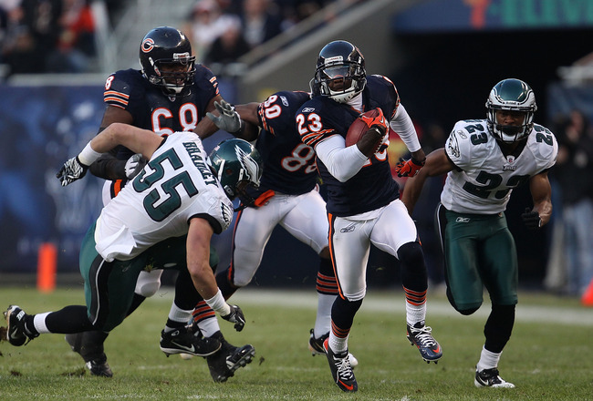 CHICAGO - NOVEMBER 28: Devin Hester #23 of the Chicago Bears breaks for a first down run of 39 yards after a catch pursued by Stewart Bradley #55 and Dimitri Patterson #23 of the Philadelphia Eagles at Soldier Field on November 28, 2010 in Chicago, Illino
